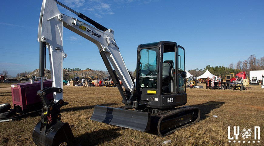 Why is buying used equipment from construction auctions a good investment?
